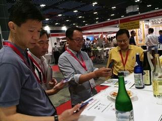 "Picture showing sakefan World testing booth at ""Oishii Japan 2015"" in Singapore."