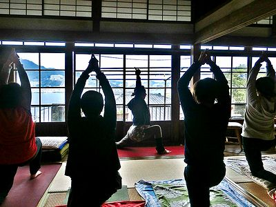 photo of Young people doing yoga in a traditional Japanese-style house