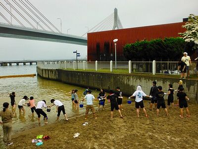 photo of Young people constructing a new beach in the area around Aomori Station